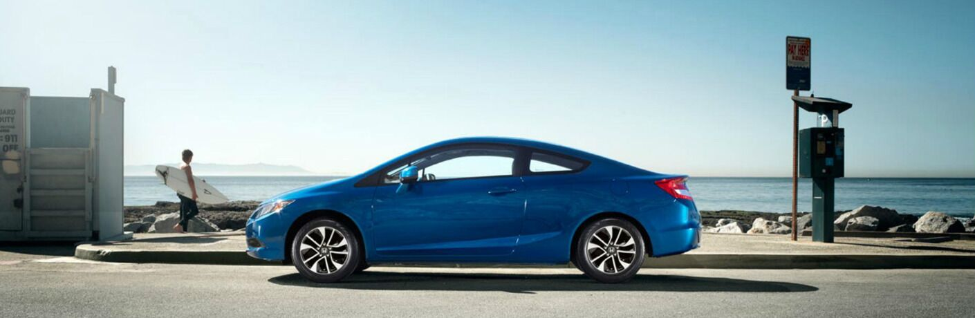 blue 2013 Honda Civic by the ocean