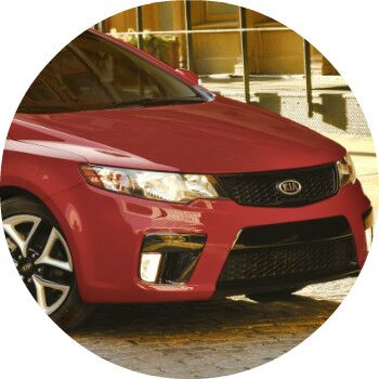 red 2013 Kia Forte front grille and headlights