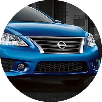 blue 2013 Nissan Maxima front grille