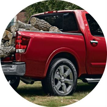 red 2013 Nissan Titan pickup bed