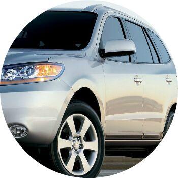 silver Hyundai Santa Fe exterior driver side
