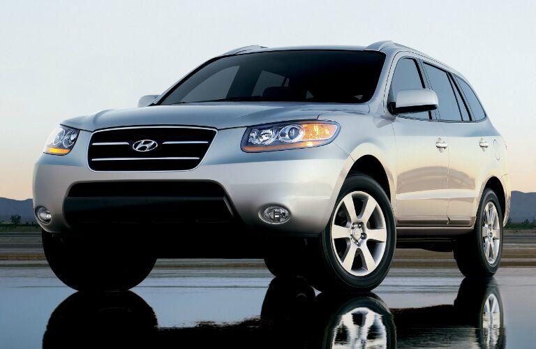 silver Hyundai Santa Fe parked on wet road