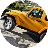 This yellow Jeep Wrangler Rubicon can crawl on rocky terrain.