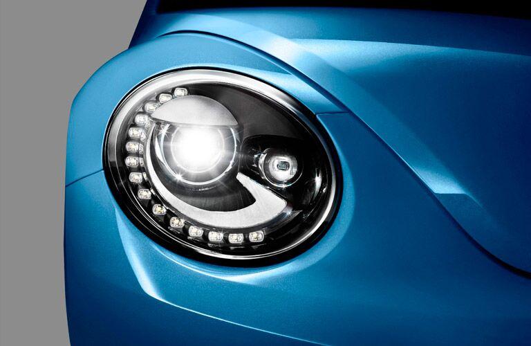 Front headlight on blue 2017 Volkswagen Beetle
