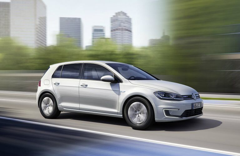 2017 Volkswagen e-Golf white speeding down the road
