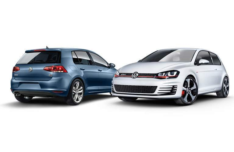 two 2014 Volkswagen Golf GTIs sitting next to each other
