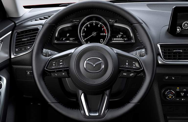 Steering wheel and gauge cluster of 2018 Mazda3