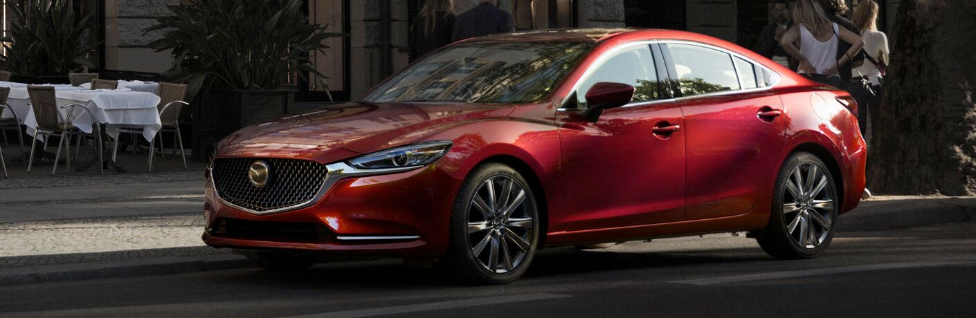 red 2018 Mazda6 parked on a street corner