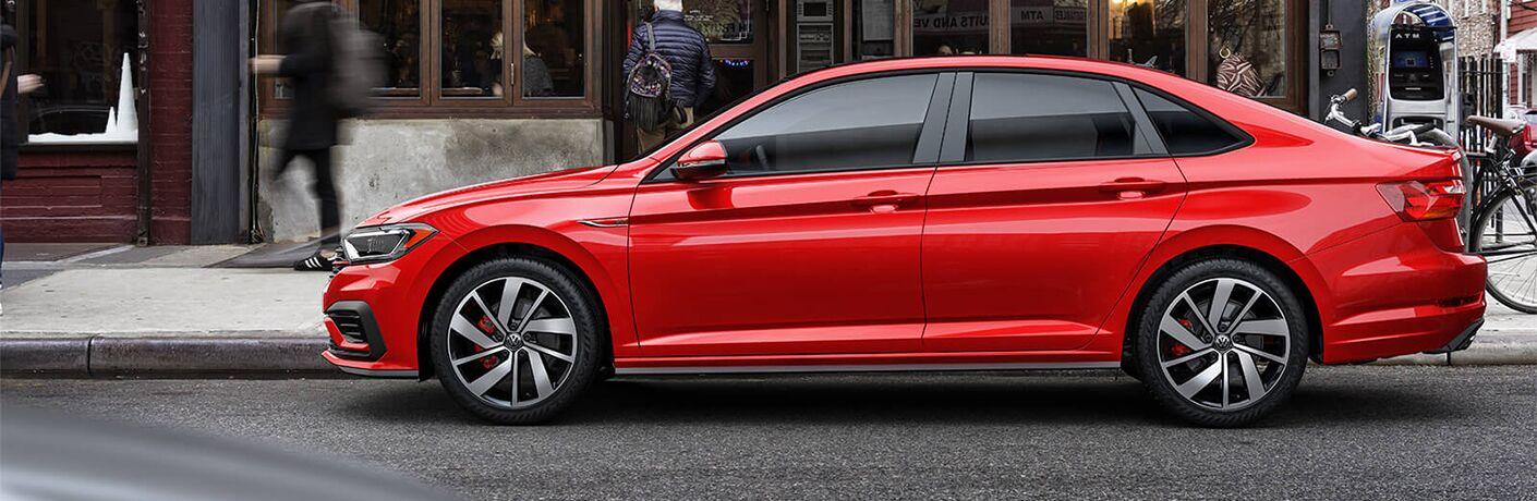 Side profile view of a red 2019 Volkswagen Jetta GLI.