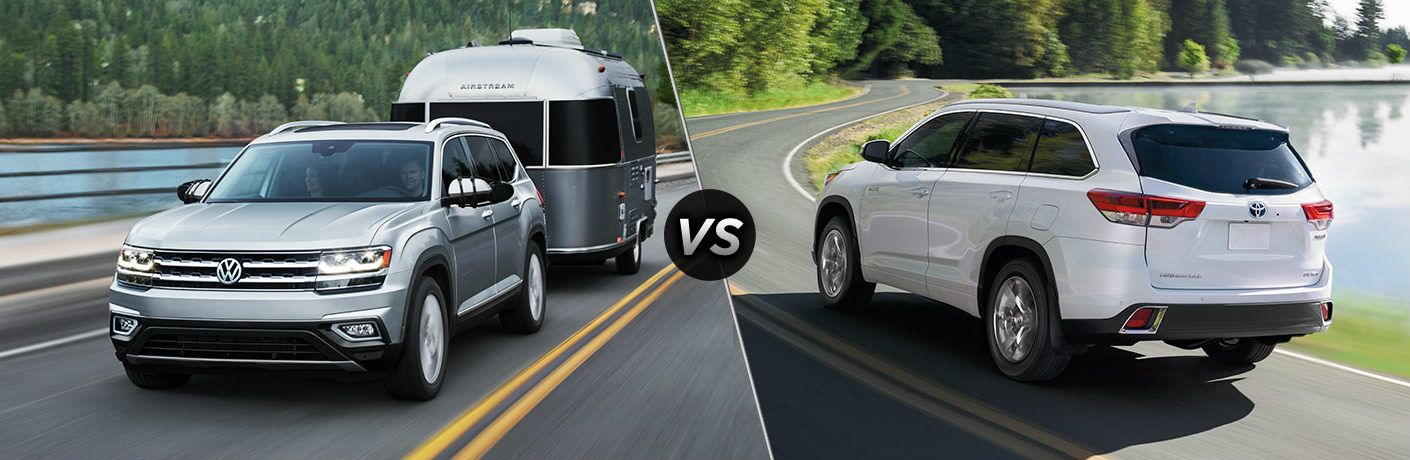 "Silver 2019 Volkswagen Atlas hauls a camper, while a white 2019 Toyota Highlander lazily drives on its own. Both vehicles are separated by a diagonal line and a ""VS"" logo."