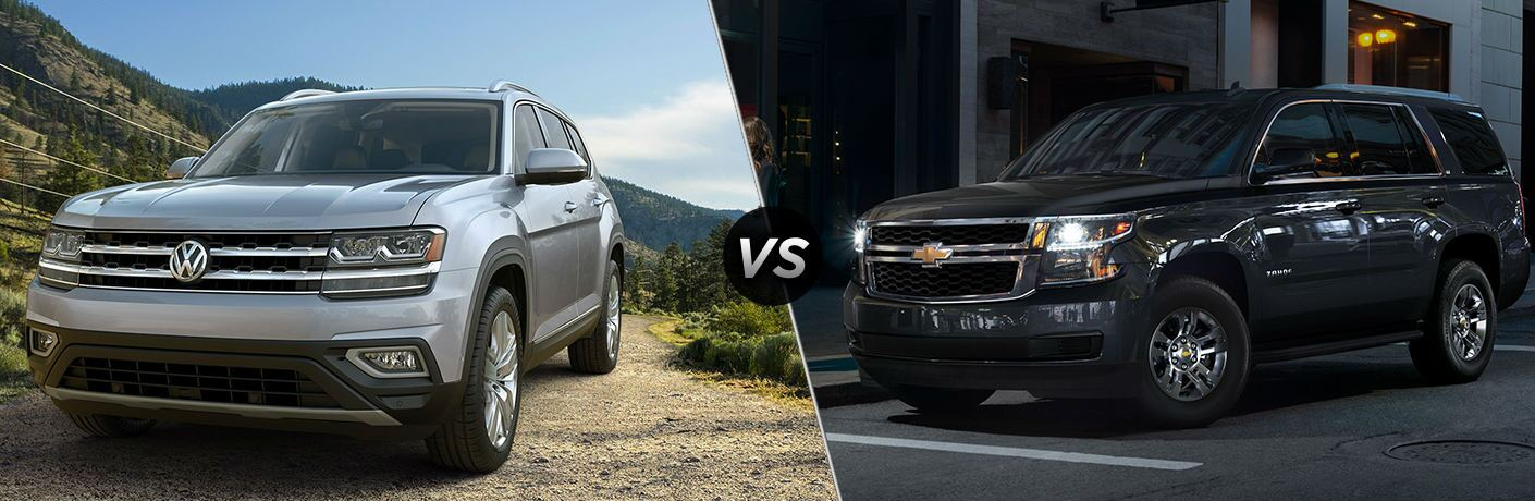 """Silver 2019 Volkswagen Atlas and black 2019 Chevrolet Tahoe, separated by a diagonal line and a """"VS"""" logo."""