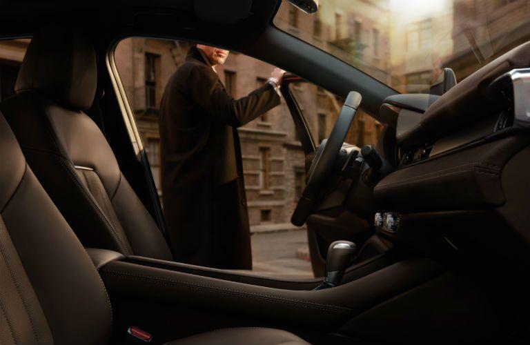 Interior of 2019 Mazda6 with man holding open door