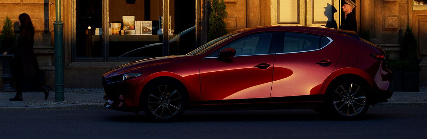 2020 MAzda3 hatchback parked near storefront