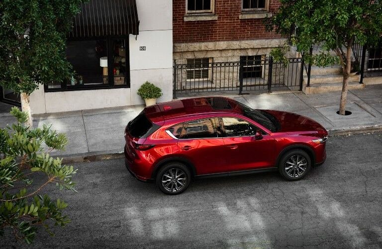2021 CX-5 parked by nice house