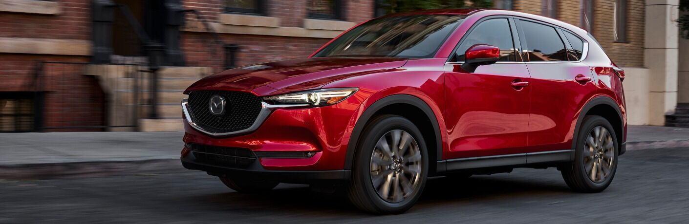 2021 CX-5 driving by brick houses