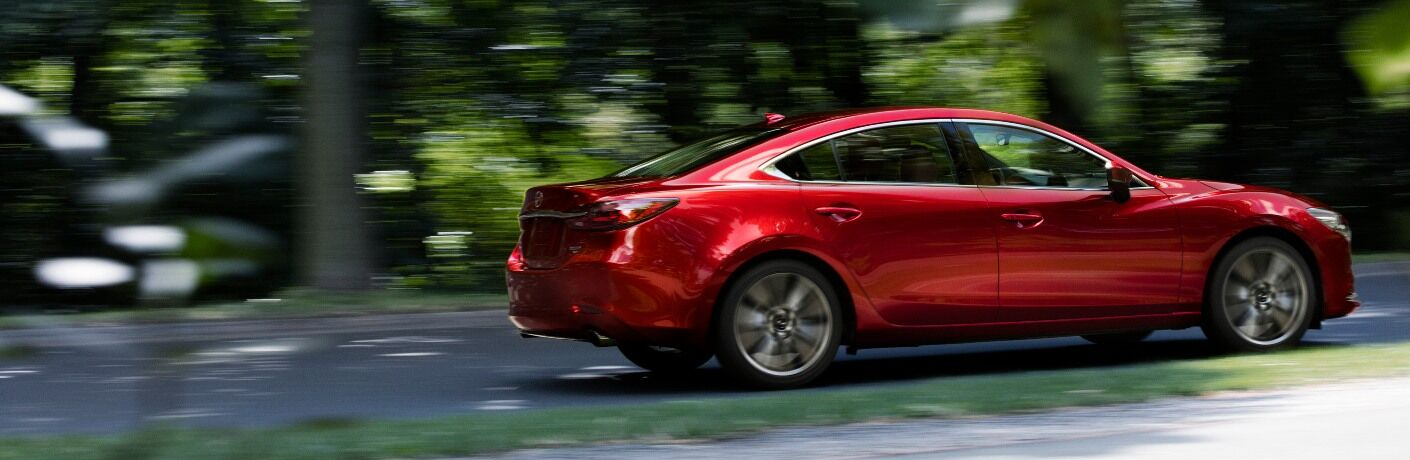2021 Mazda6 driving on wooded road