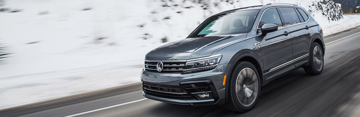 2021 Tiguan driving by snowy incline
