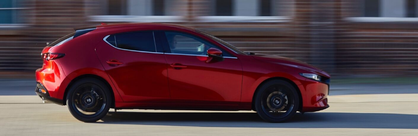 2021 Mazda3 driving in front of houses