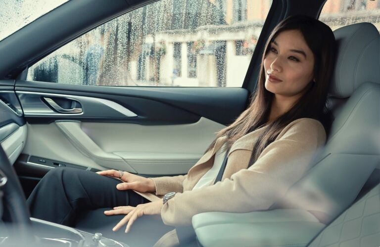 2021 CX-9 woman sitting in passenger seat