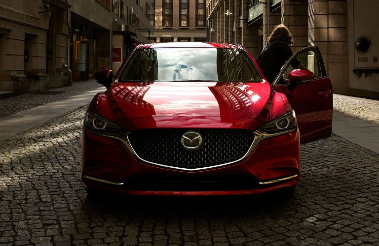 Frontal exterior shot of 2019 Mazda6 with man getting out of car