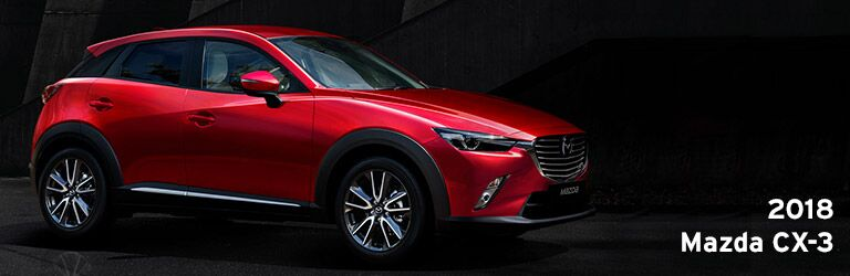 red 2018 Mazda CX-3 in a dark alley