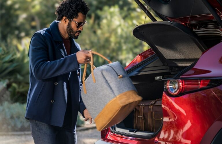 man loading bags into 2020 CX-30