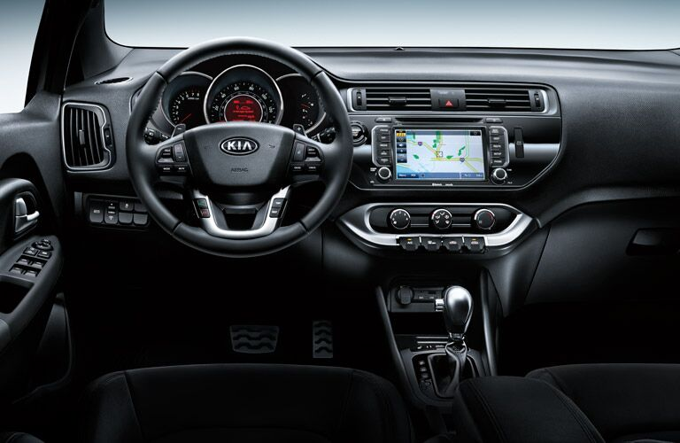 steering wheel and UVO infotainment display in the 2016 Kia Rio