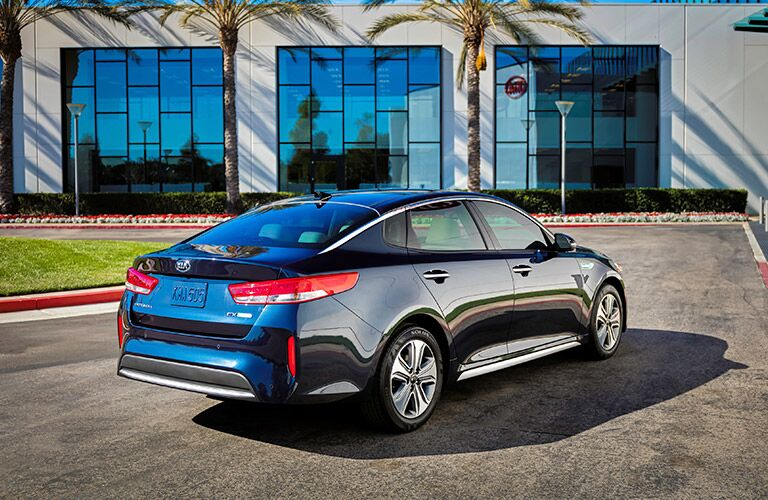 rear view of the 2017 Kia Optima Hybrid in front of fancy windows