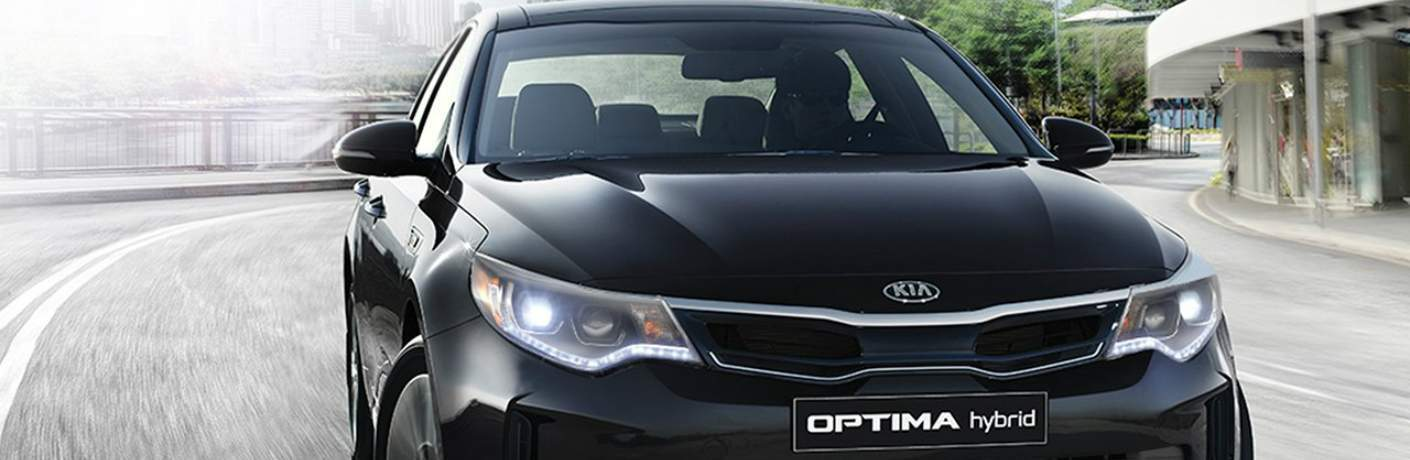2018 Kia Optima Hybrid Driving Away From Town