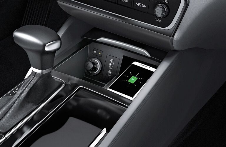 Interior closeup view of the wireless charging feature inside a 2019 Kia Cadenza