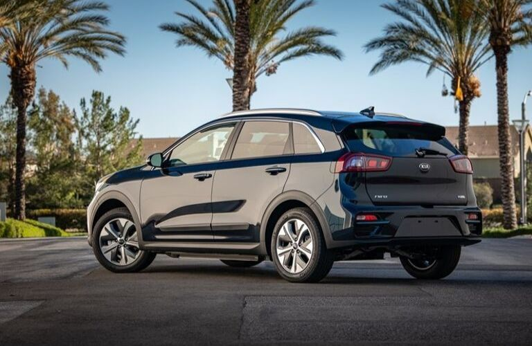 Exterior view of the rear of a dark blue 2020 Kia Niro EV