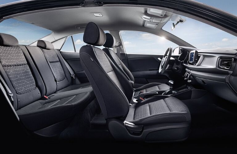Interior view of the front and rear seating areas inside a 2019 Kia Rio