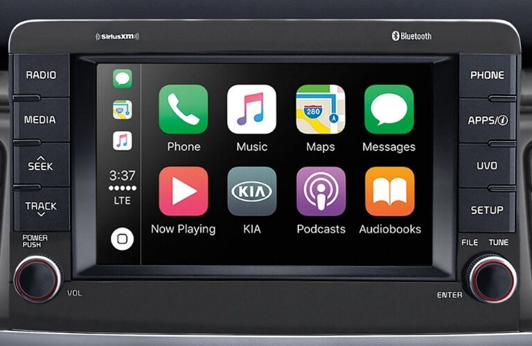 Closeup interior view of Apple CarPlay™ on the touchscreen inside a 2019 Kia Rio