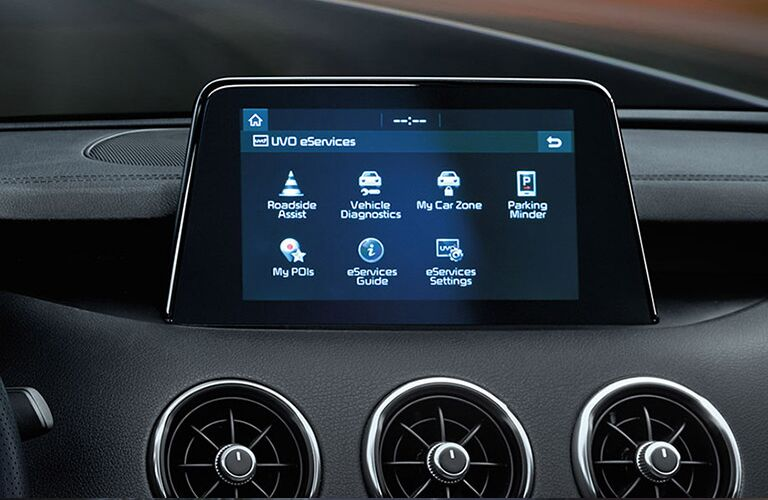 Closeup view of the touchscreen with UVO eServices inside a 2019 Kia Stinger