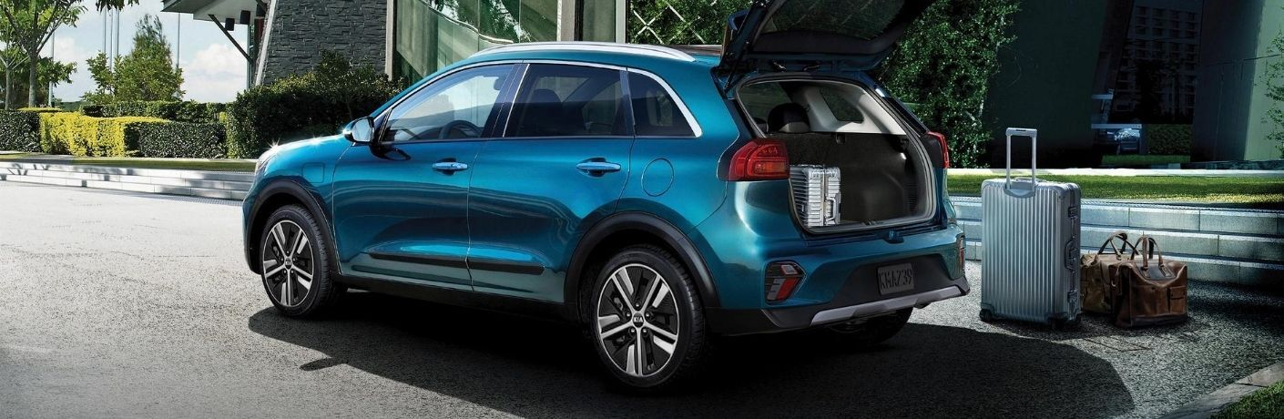 Exterior view of a blue 2020 Kia Niro Plug-In Hybrid with its rear hatch open