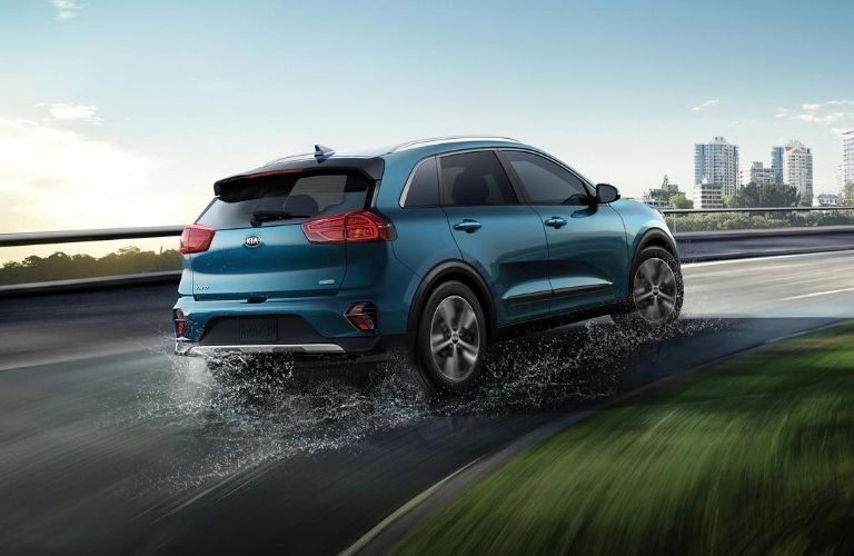 Exterior view of the rear of a blue 2020 Kia Niro Plug-In Hybrid