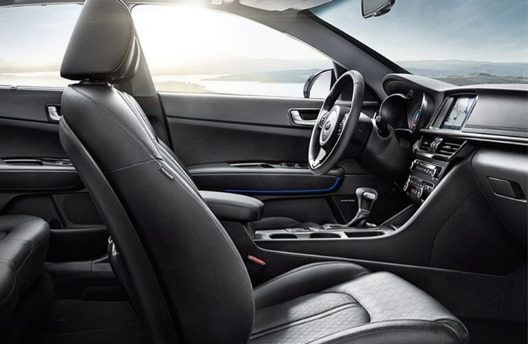Interior view of the front seating area inside a 2019 Kia Optima Hybrid