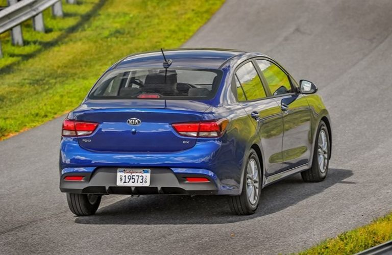 Exterior view of the rear of a blue 2020 Kia Rio