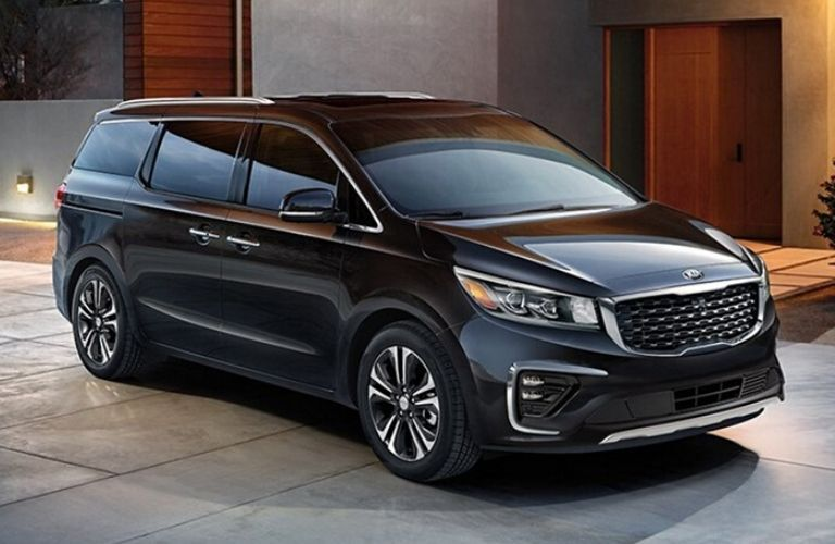 Exterior view of the front of a black 2020 Kia Sedona