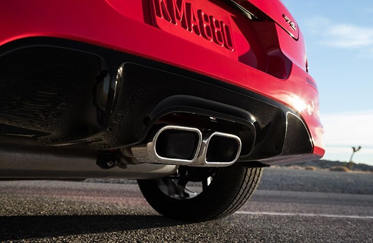 Exterior closeup view of the rear bumper and exhaust on a red 2020 Kia Soul