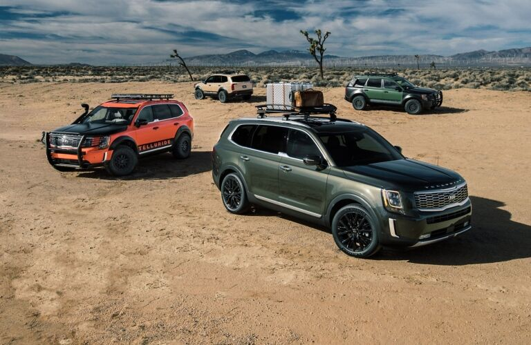 Exterior view of four 2020 Kia Telluride models parked in the desert