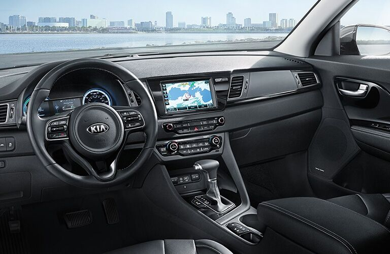 front interior of 2018 kia niro including steering wheel and infotainment system