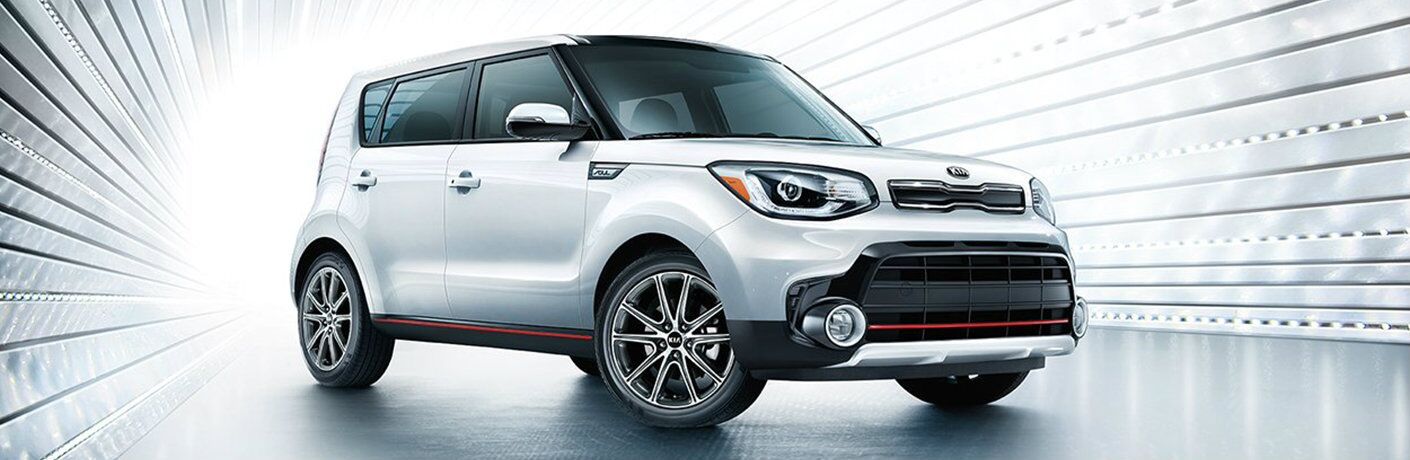 white 2018 kia soul against white background