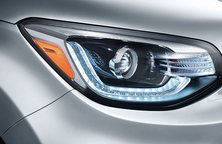close up of head light on silver 2018 kia soul