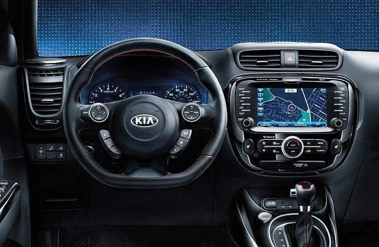 Steering wheel and touchscreen of 2018 Kia Soul with gear shifter shown