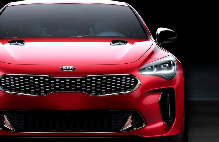front bumper and grille of red 2018 kia stinger