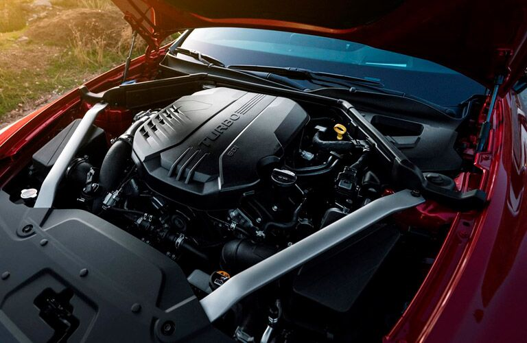 red 2018 kia stinger with hood open showing engine compartment
