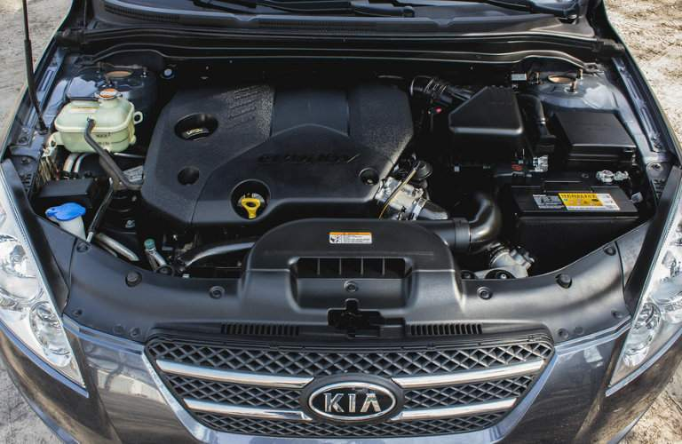 Shot of Kia vehicle with hood open exposing engine