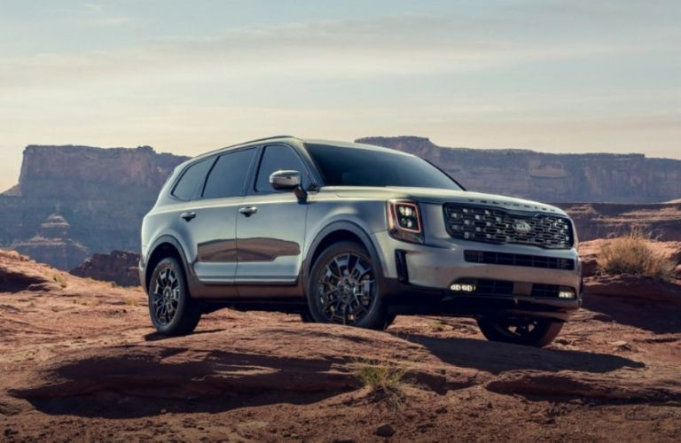 2021 Kia Telluride parked outside on rocks