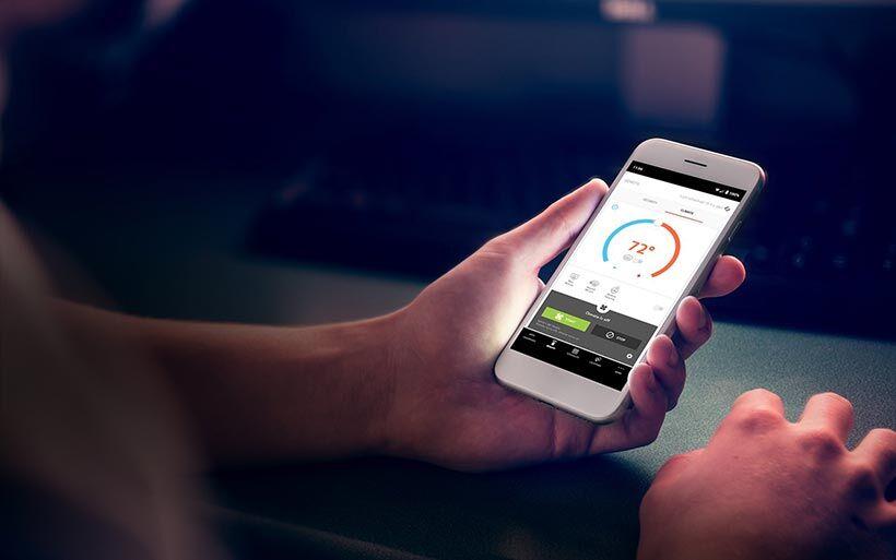 Someone using Kia's UVO app on a smartphone